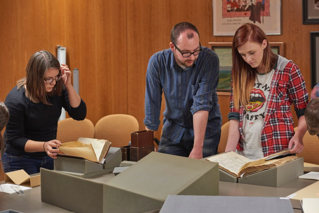 Utah State students examine manuscripts