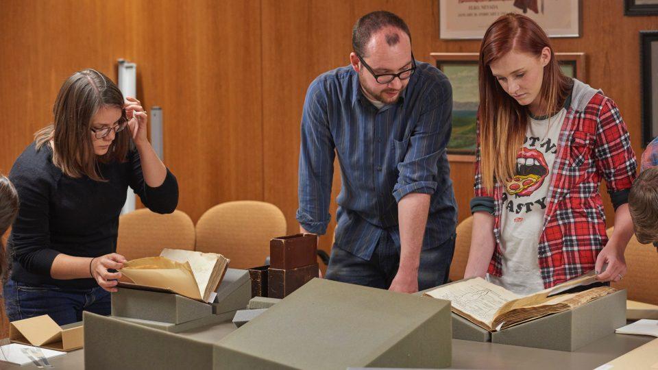 Utah State students examine manuscripts